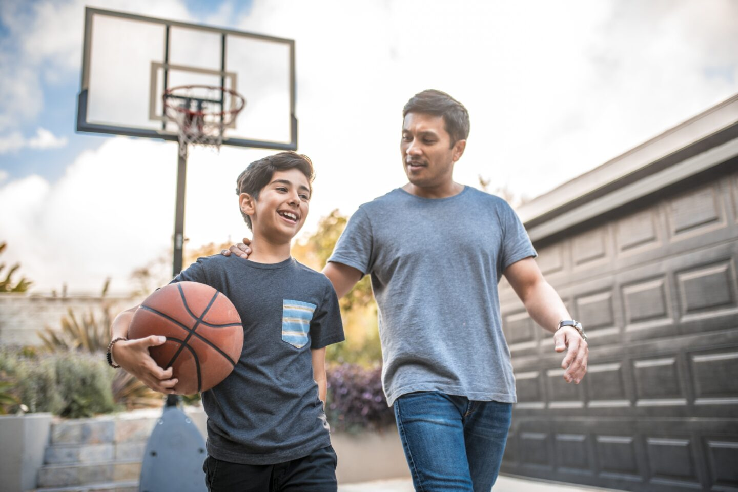 Father playing basketball with son
